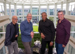 Beats founders Jimmy Iovine (L) and Dr. Dre (second from R) will join the Apple team, pictured here with CEO Tim Cook (second from L) and Eddy Cue (R), senior vice president of Internet Software and Services.