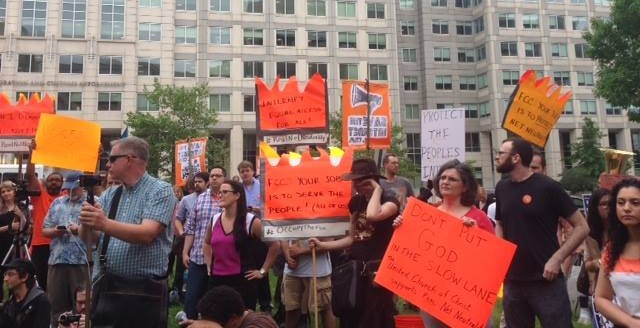 Protesters outside the FCC ahead of the open meeting where the agency will start its net neutrality proceedings. Credit: Free Press