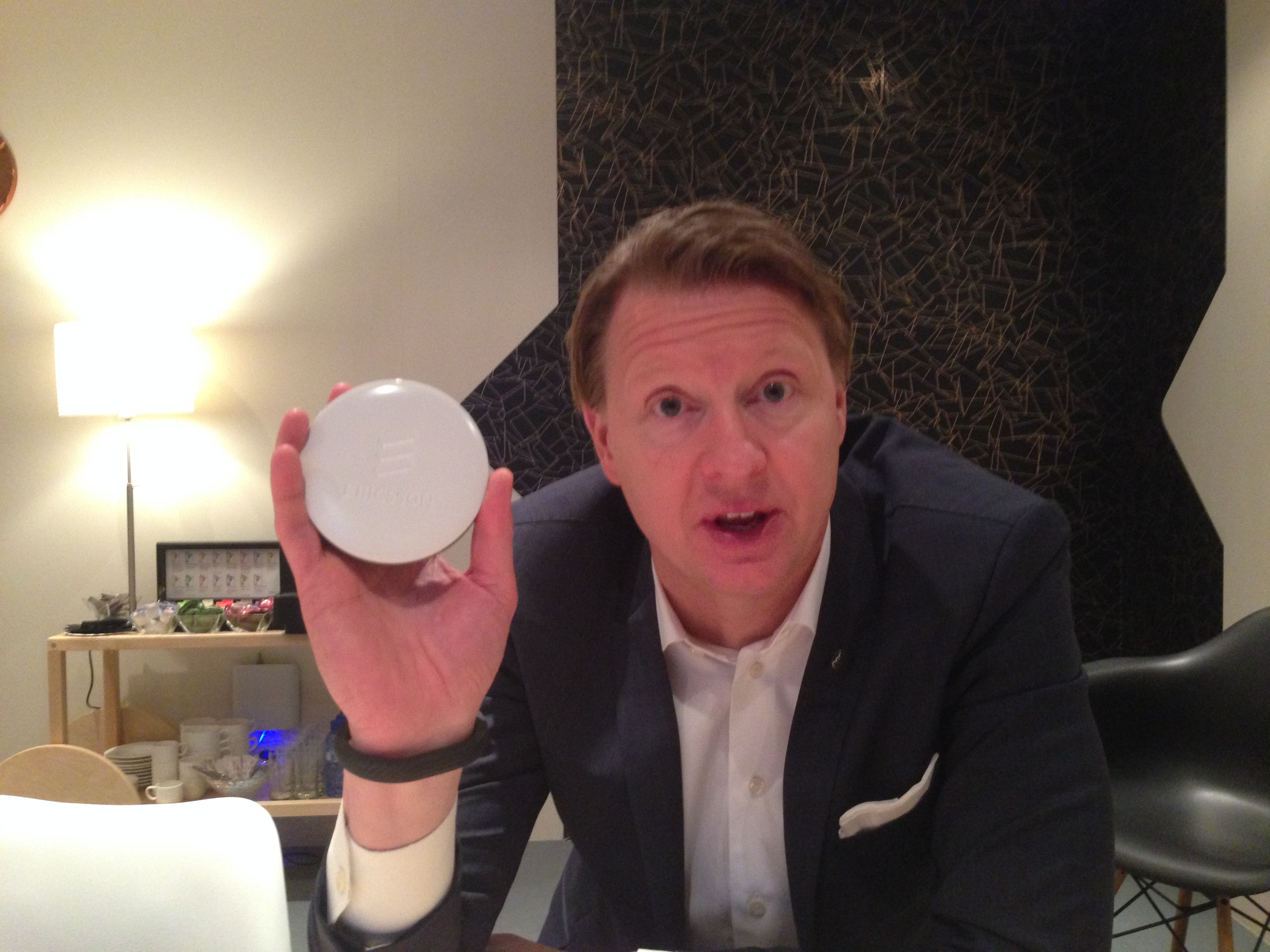 Ericsson CEO Hans Vestberg holds up his company's newest small cell, the Radio Dot (Photo by Kevin Fitchard)