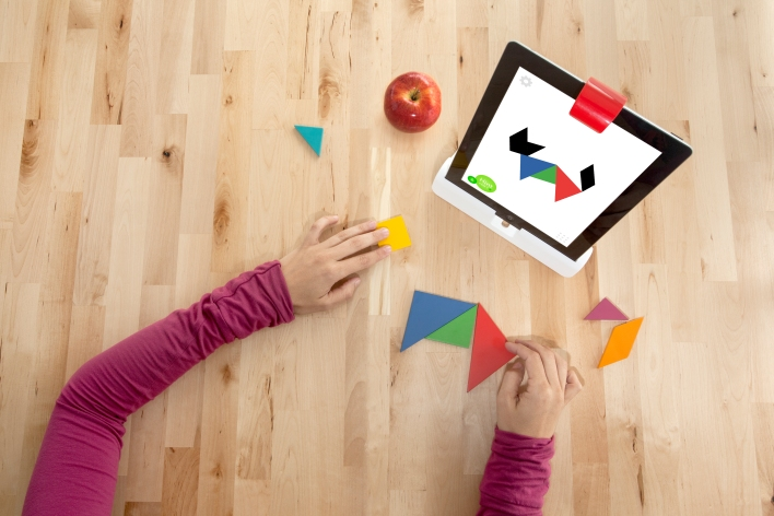 Osmo's camera mirror allows the iPad to recognize objects placed in front of it, extending game play into the real world.