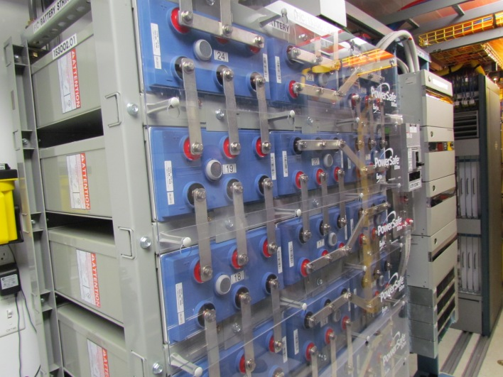 A bank of batteries fed by a mobile power plant: All power has to be converted from AC to DC to protect against power surges. (Photo: Kevin Fitchard)
