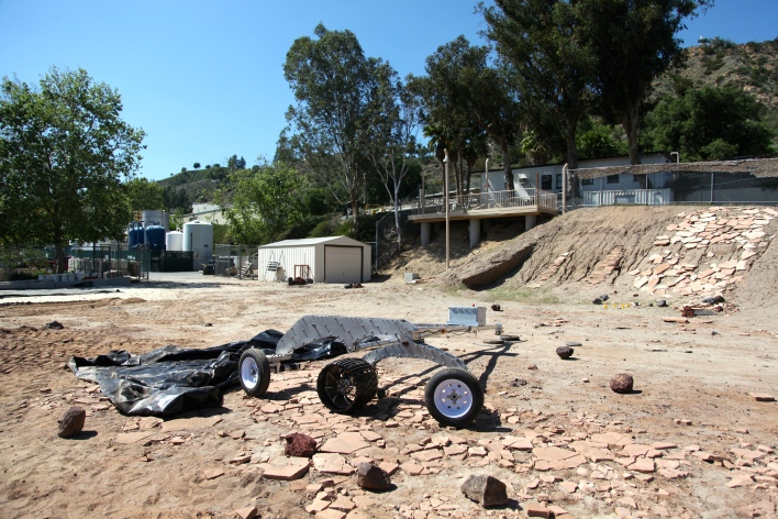 The Mars Yard at NASA Jet Propulsion Lab is littered with sandy soil and rocks that resemble the terrain on Mars. When I visited in April, a JPL team was rapidly running a set of wheels in a circle to test how wear and tear could affect Curiosity's ability to drive. Photo by Signe Brewster.