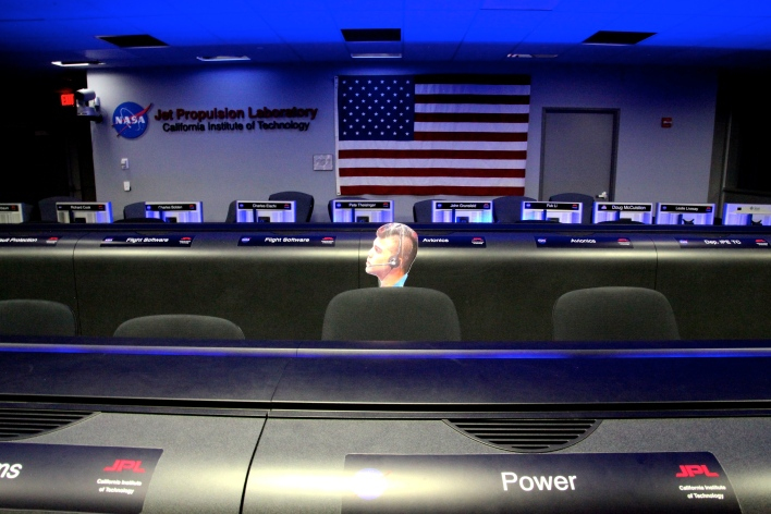 "Curiosity's 2012 landing on Mars was overseen from the mission control room at NASA Jet Propulsion Lab. A picture of systems engineer Bobak Ferdowski, AKA ""Mohawk Guy,"" marks where he sat during the landing. Photo by Signe Brewster."