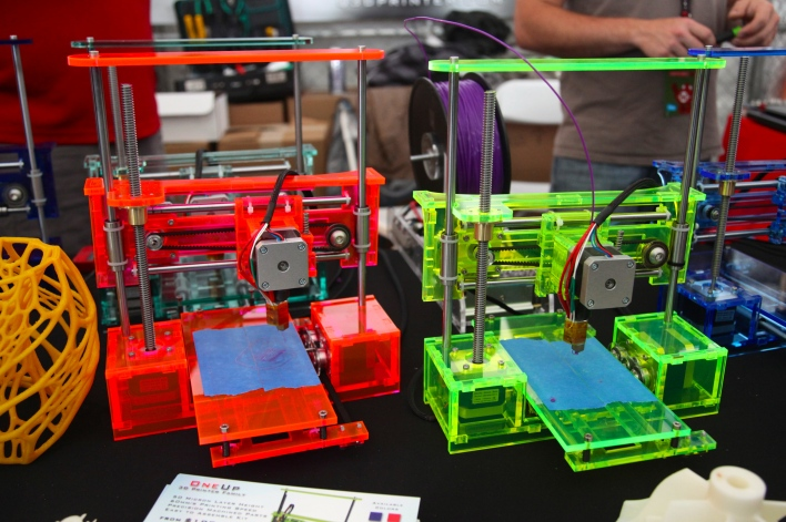 QU-BD exhibited its One Up 3D printers in some funky colors. Photo by Signe Brewster.