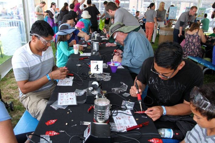 An entire tent was devoted to teaching attendees how to solder. Photo by Signe Brewster.