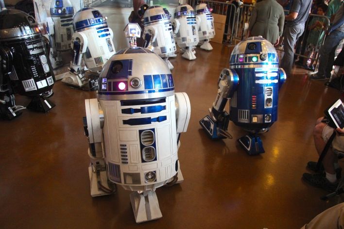 A flock of R2-D2s greets visitors at the entrance to the Dark Room building. Photo by Signe Brewster.