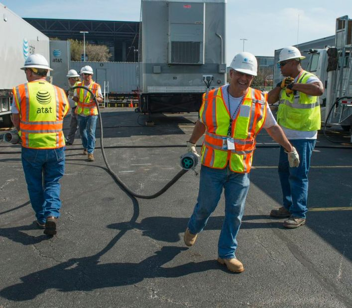 An AT&T National Disaster Recovery crew connecting power cables (Photo: AT&T)