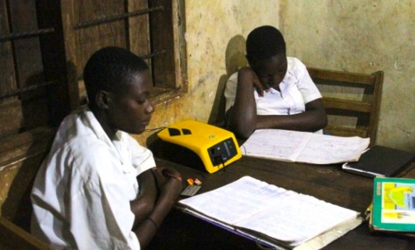 School kids studying with ReadySet batteries for lighting from Fenix International