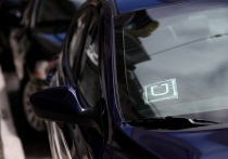 A sticker with the Uber logo is displayed in the window of a car on June 12, 2014 in San Francisco, California. (Photo by Justin Sullivan/Getty Images)