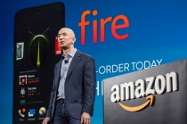 Amazon.com founder and CEO Jeff Bezos presents the company's first smartphone, the Fire Phone, on June 18, 2014 in Seattle, Washington. The much-anticipated device is available for pre-order today and is available exclusively with AT&T service.  (Photo by David Ryder/Getty Images)