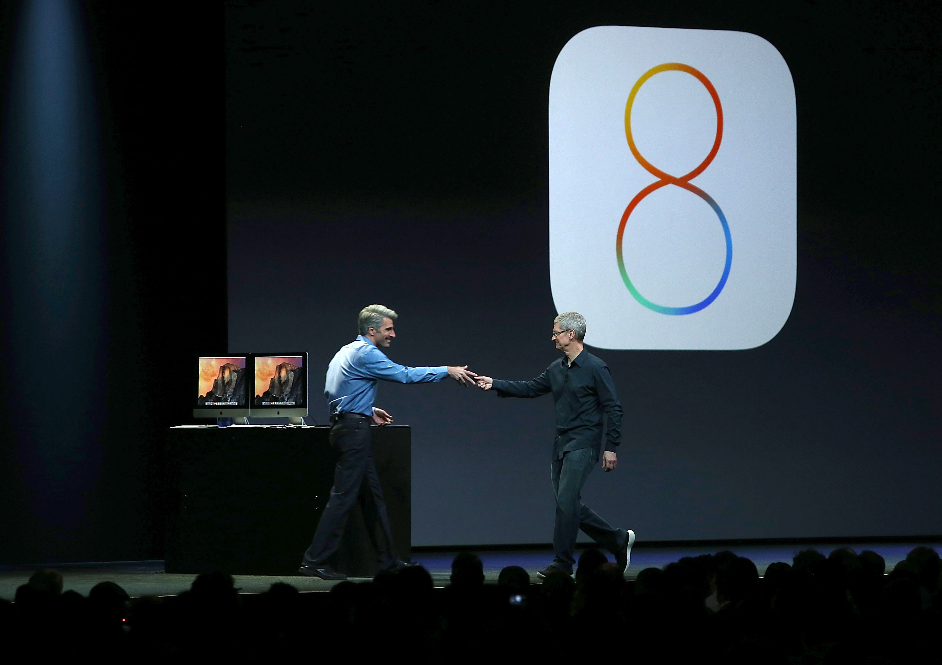 pple Senior Vice President of Software Engineering Craig Federighi (L) and Apple CEO Tim Cook speak during the Apple Worldwide Developers Conference at the Moscone West center on June 2, 2014 in San Francisco, California.  (Photo by Justin Sullivan/Getty Images)