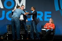 Marten Mickos, Eucalyptus Systems; Chris Kemp, Nebula; and Sameer Dholakia of Citrix Systems work hug over the open cloud.