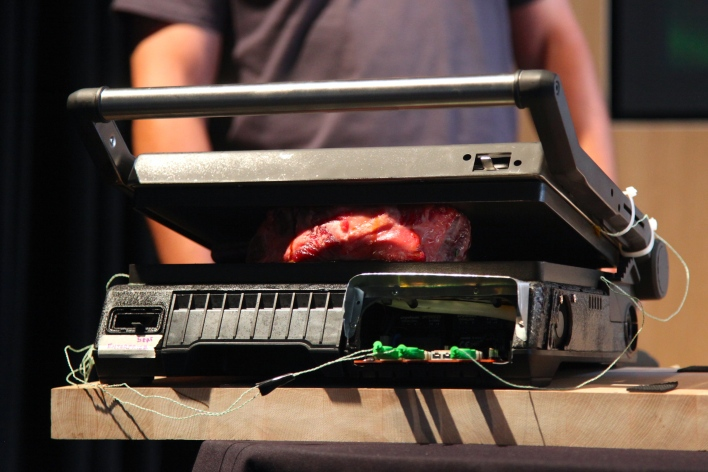 A steak cooks on a prototype of the Palate Precision Grill. Photo by Signe Brewster.