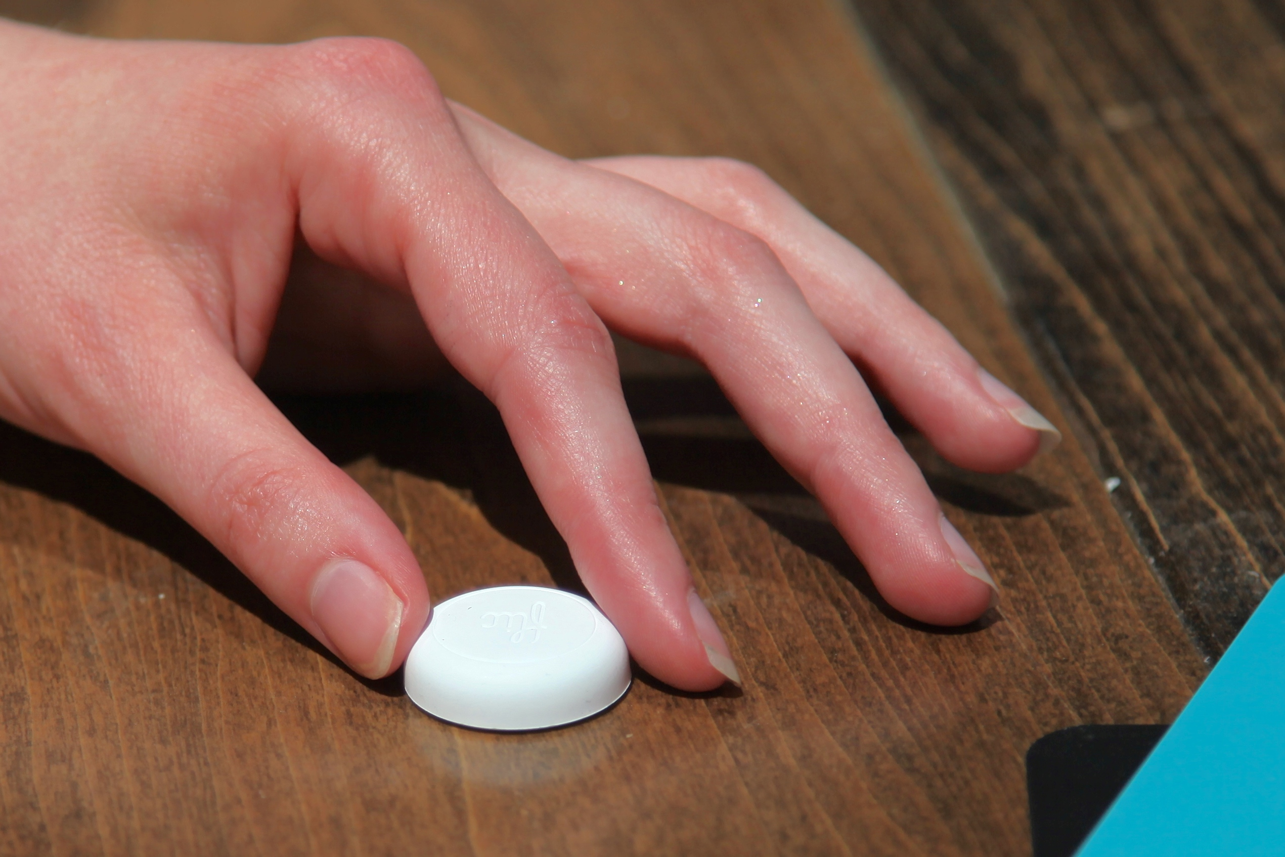 The Flic wireless button. Photo by Signe Brewster.