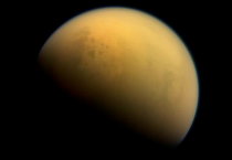 Using a special spectral filter, the high-resolution camera aboard NASA's Cassini spacecraft was able to peer through the hazy atmosphere of Saturn's moon Titan. It captured this image, which features the largest seas and some of the many hydrocarbon lakes that are present on Titan's surface.