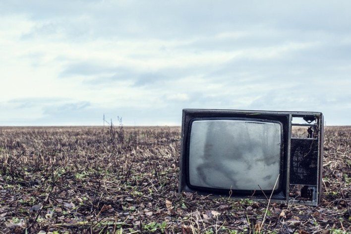 Broken, tossed TV, courtesy of sinada / Shutterstock.
