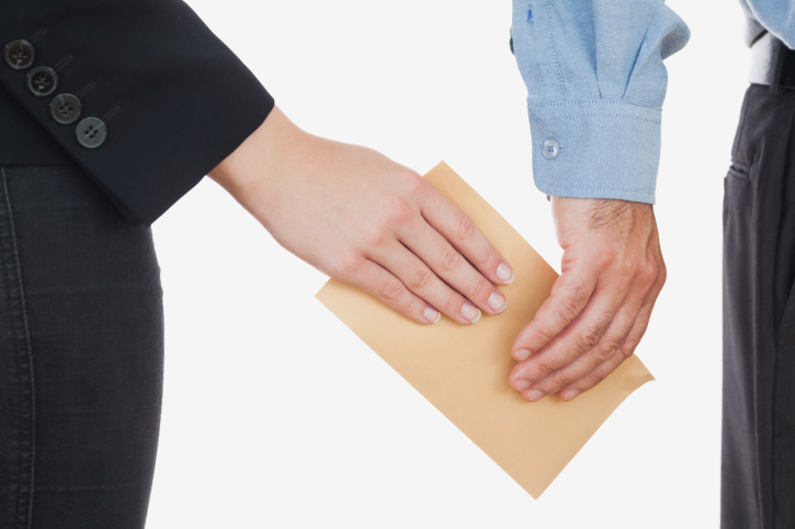 Collusion Generic - envelope secretly exchanging hands