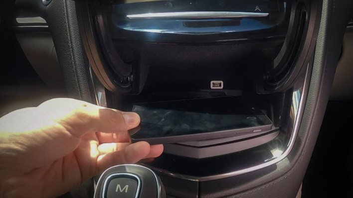 A compartment behind the infotainment system will contain the new multi-standard charge pad in the Cadillac ATS. (Source: GM)