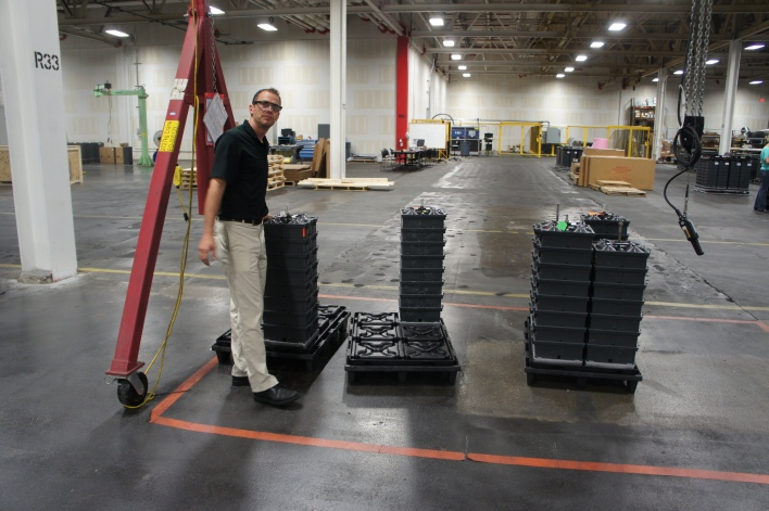 Aquion Energy founder Jay Whitacre standing next to a battery stack. Image courtesy of Katie Fehrenbacher, Gigaom.