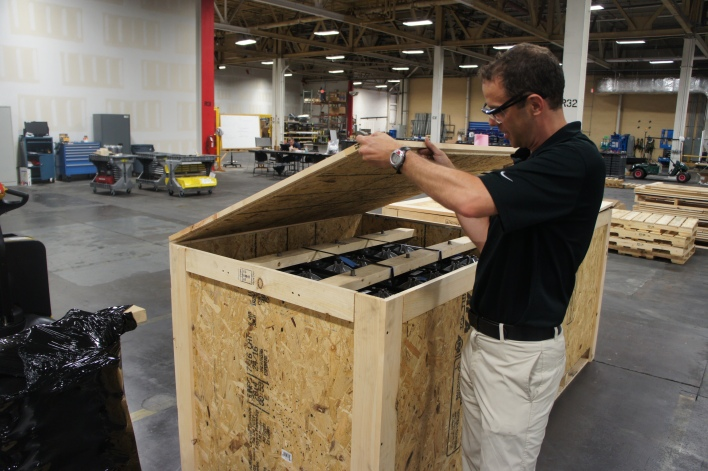 Aquion Energy founder and CTO Jay Whitacre inspects a battery that's ready to ship to a customer. Image courtesy of Katie Fehrenbacher, Gigaom.