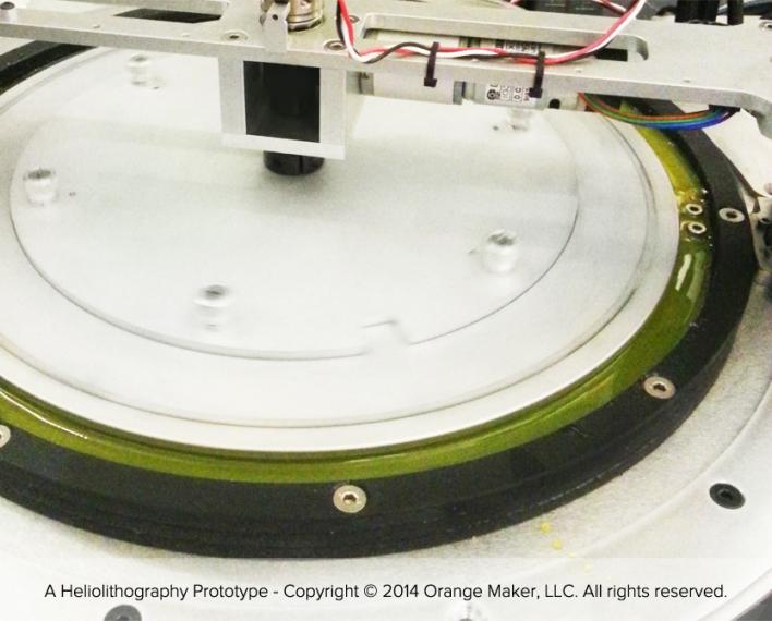 A closeup of Orange Maker's prototype 3D printer. Photo courtesy of Orange Maker.