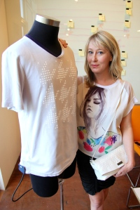 CEO Alison Lewis with the Switch Embassy shirt and purse. Photo by Signe Brewster.