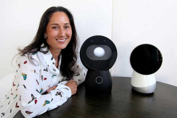 CEO Cynthia Breazeal with a Jibo prototype, left, and a mockup of what the final design will look like. Photo by Signe Brewster.