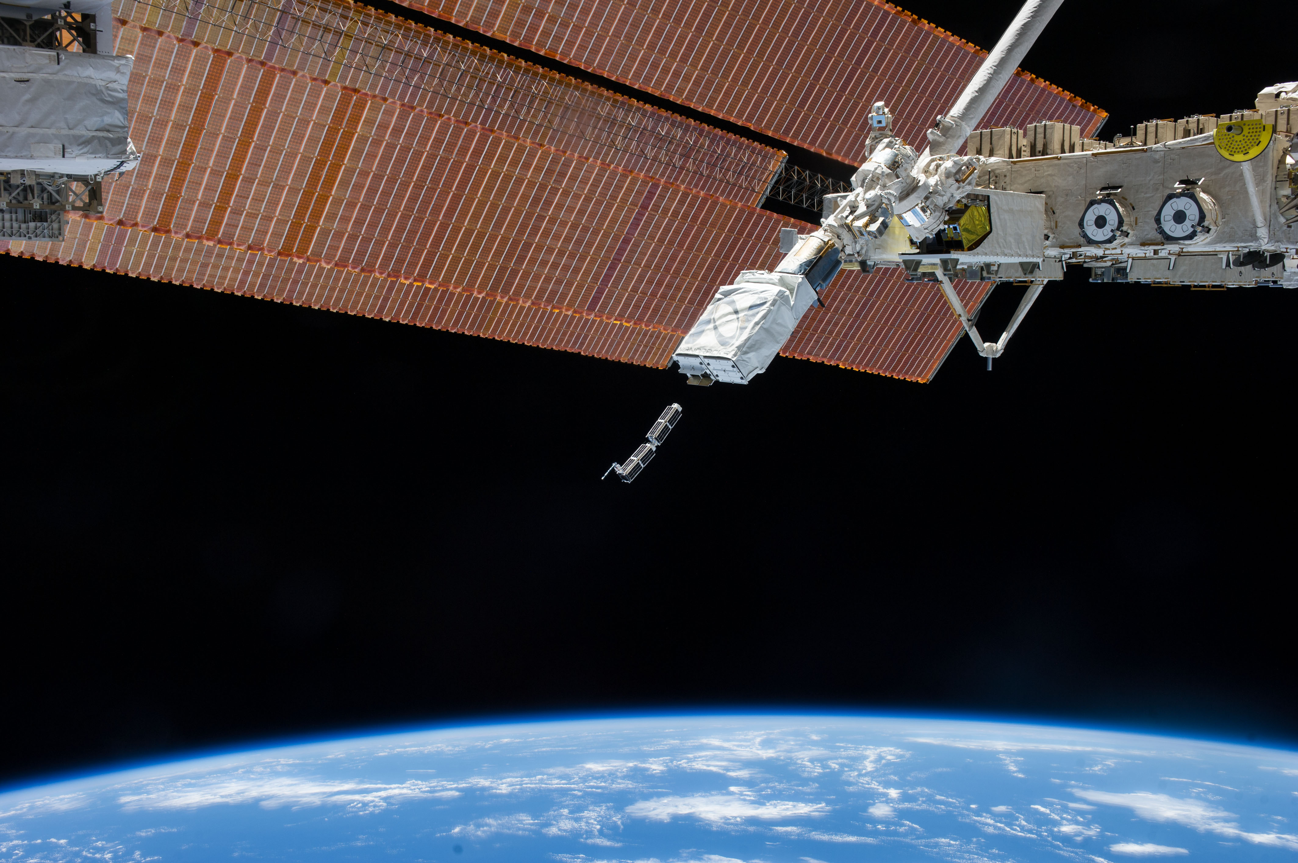 A Planet Labs dove satellite is released from the International Space Station. Photo courtesy of Planet Labs.