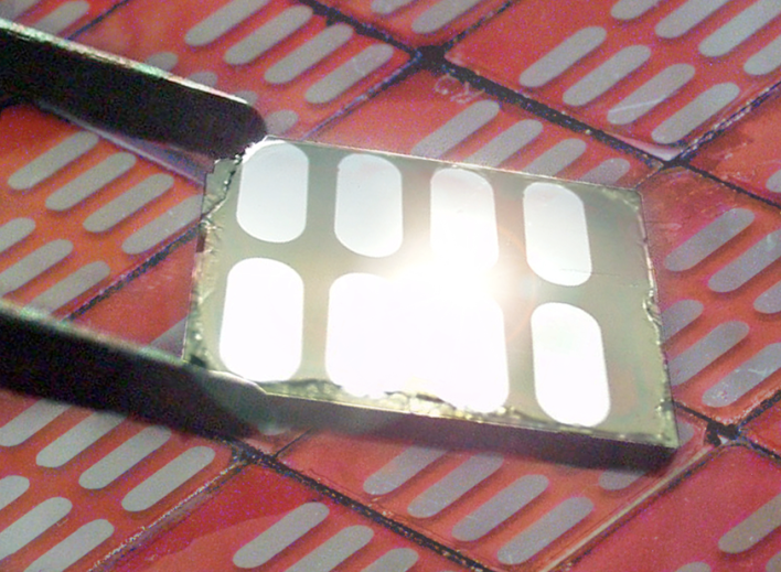 A new type of efficient solar cell made within Berkeley Lab, image courtesy of Berkeley Lab, photo by Roy Kaltschmidt.