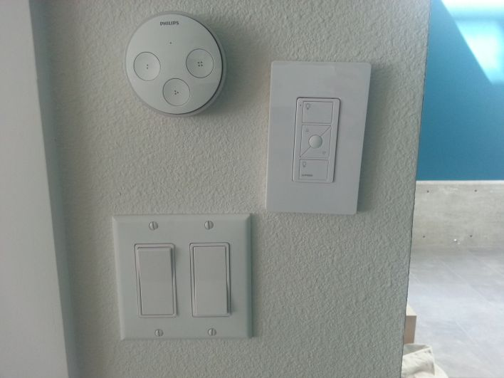 From top clockwise. The Hue tap, the Lutron Pico remote in a wall plate and a normal switch.