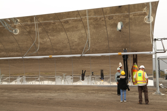 The 20-foot mirrors dwarf, and distort, anyone standing under them. Image courtesy of Katie Fehrenbacher, Gigaom.
