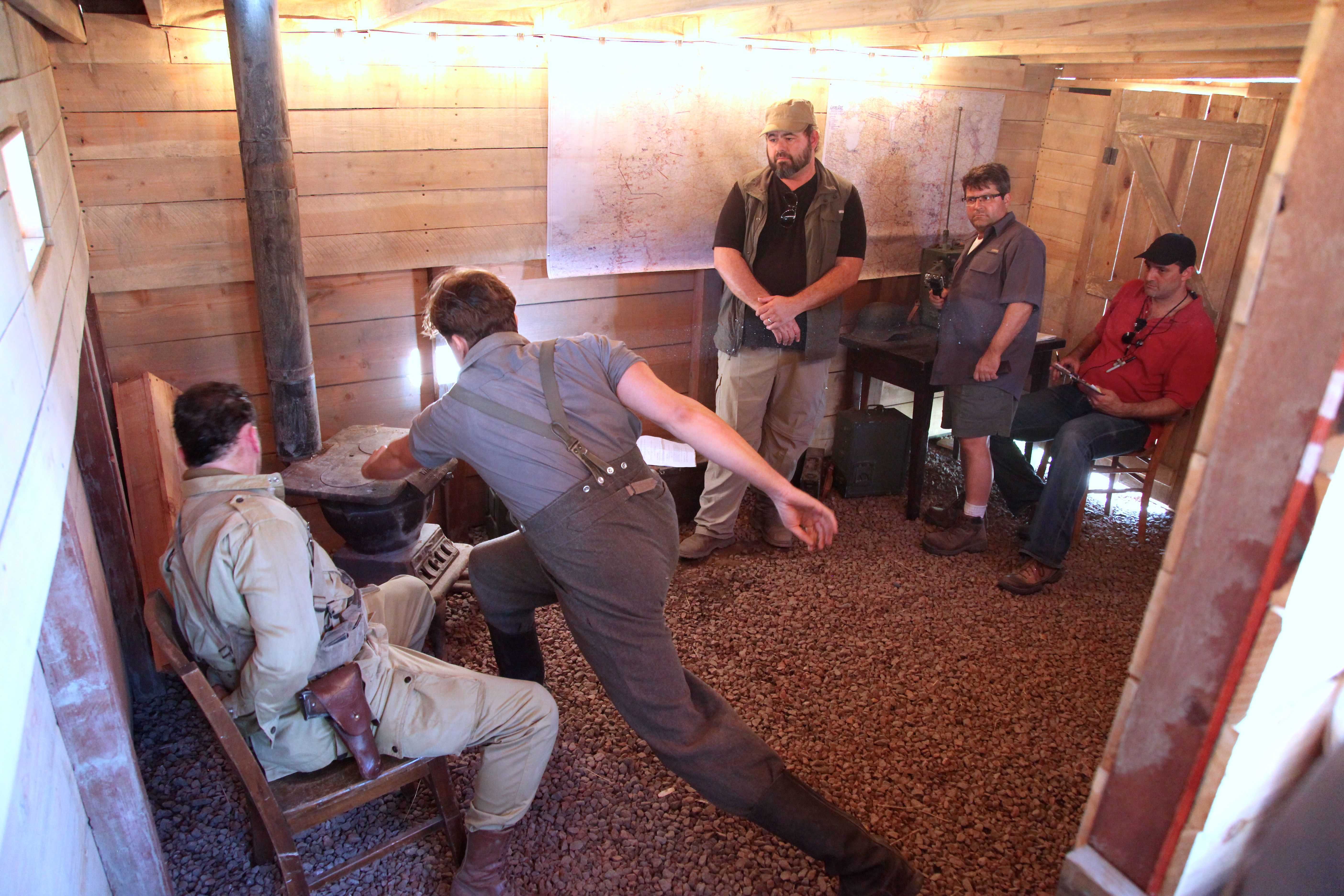 An actor pretends to hit his captive with a gun during a practice run-through in the bunker. Photo by Signe Brewster.