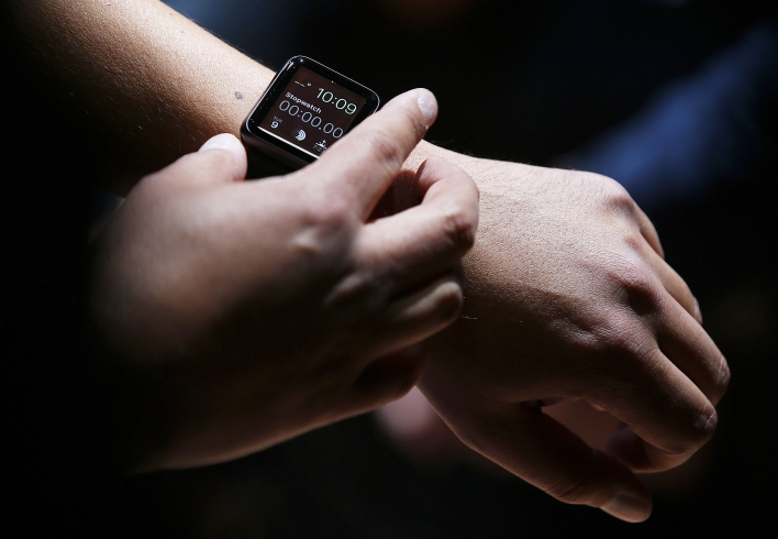 An attendee inspects the new Apple Watch.  (Photo by Justin Sullivan/Getty Images)