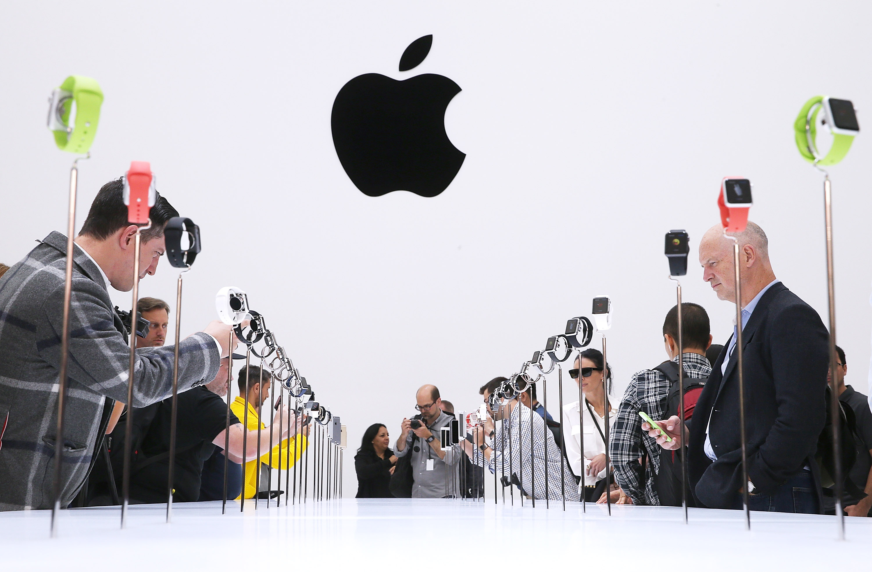Attendees look at a display of the new Apple Watch during an Apple special event.  (Photo by Justin Sullivan/Getty Images)