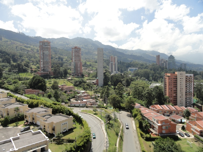 The sun rises on El Poblado, an upscale neighborhood on the mountainside surrounding Medellín, Colombia. Photo by Jamie Stark.