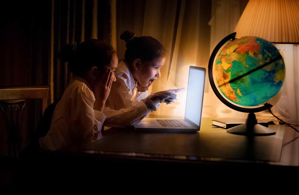 Girls using laptop at night