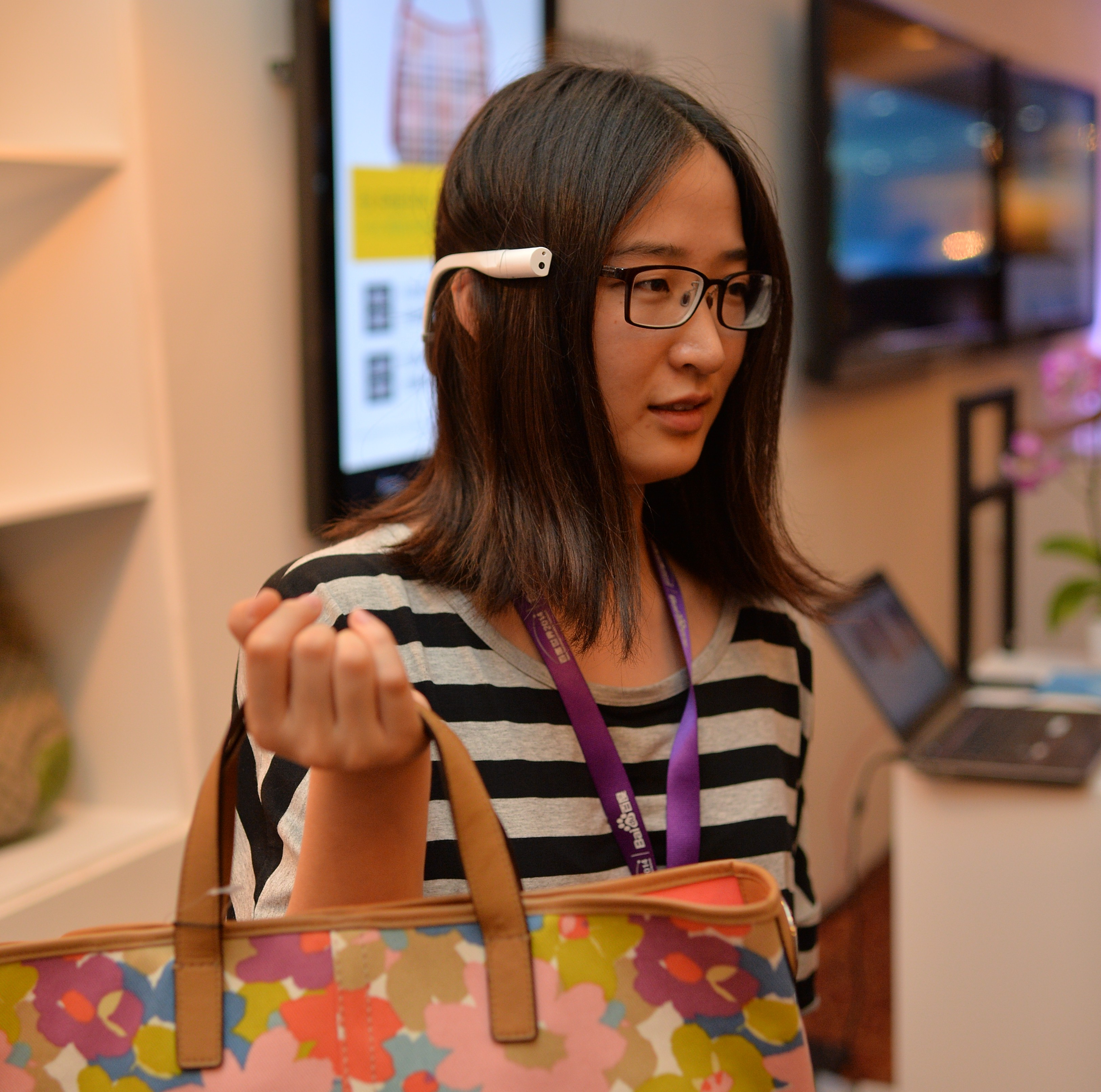 A Baidu World attendee tests out Baidu Eyes ability to recognize handbags. Source: Baidu
