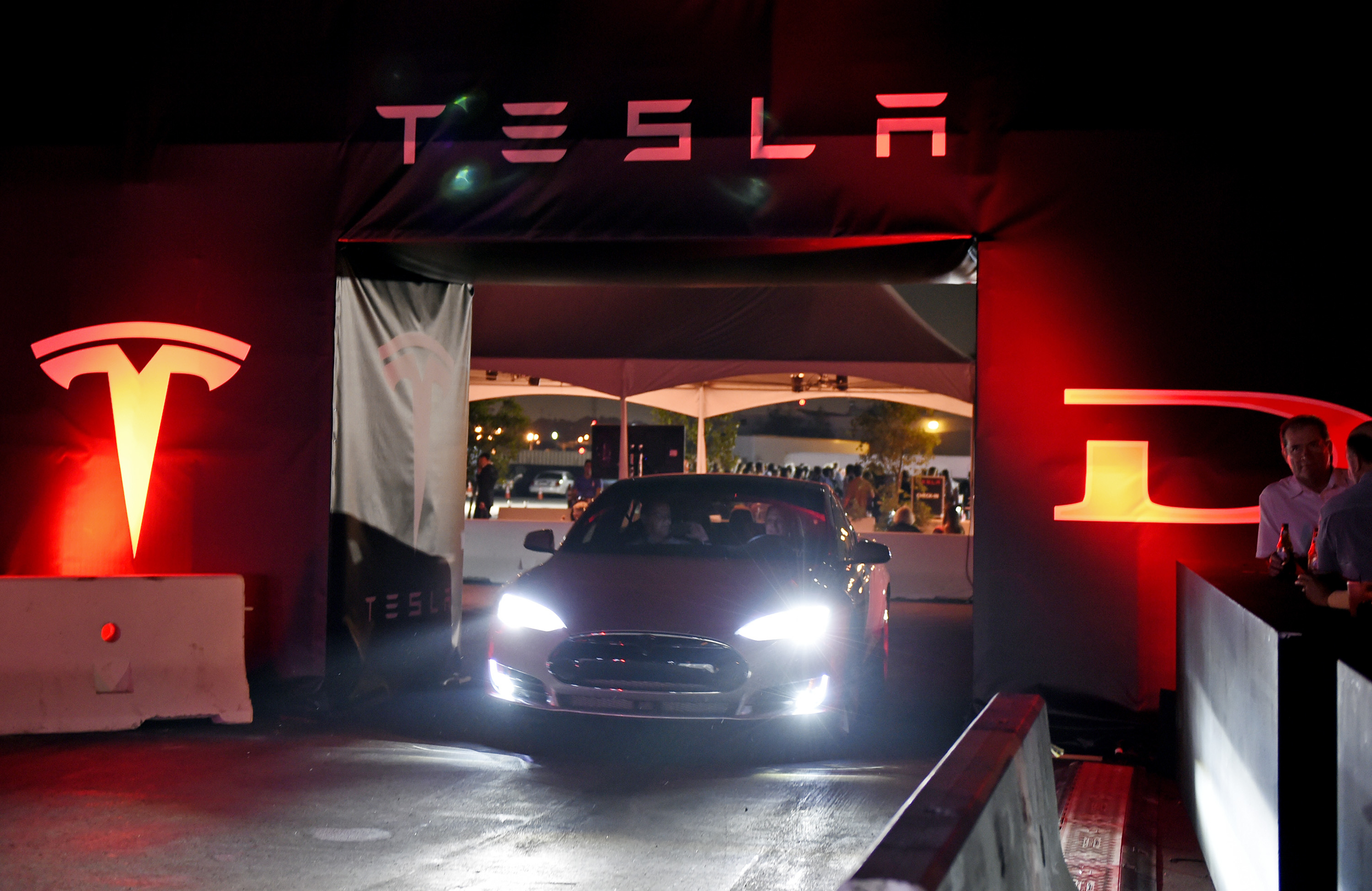 "Tesla owners take a ride in the new Tesla ""D"" model electric sedan at the Hawthorne Airport on October 09, 2014 in Hawthorne, California."