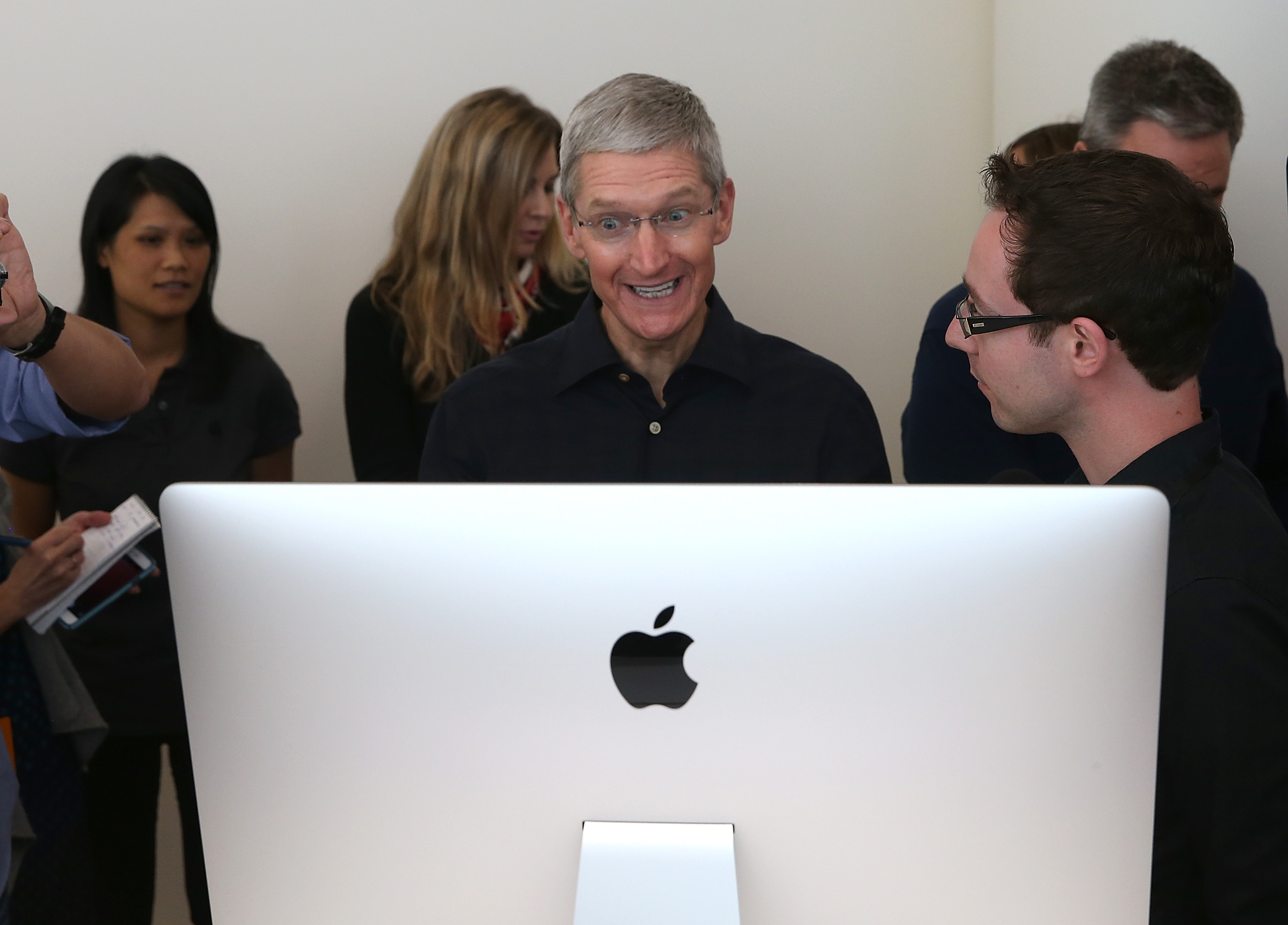 Apple CEO Tim Cook looks at the new 27 inch iMac with 5K retina display during an Apple special event on October 16, 2014 in Cupertino, California. (Photo by Justin Sullivan/Getty Images)