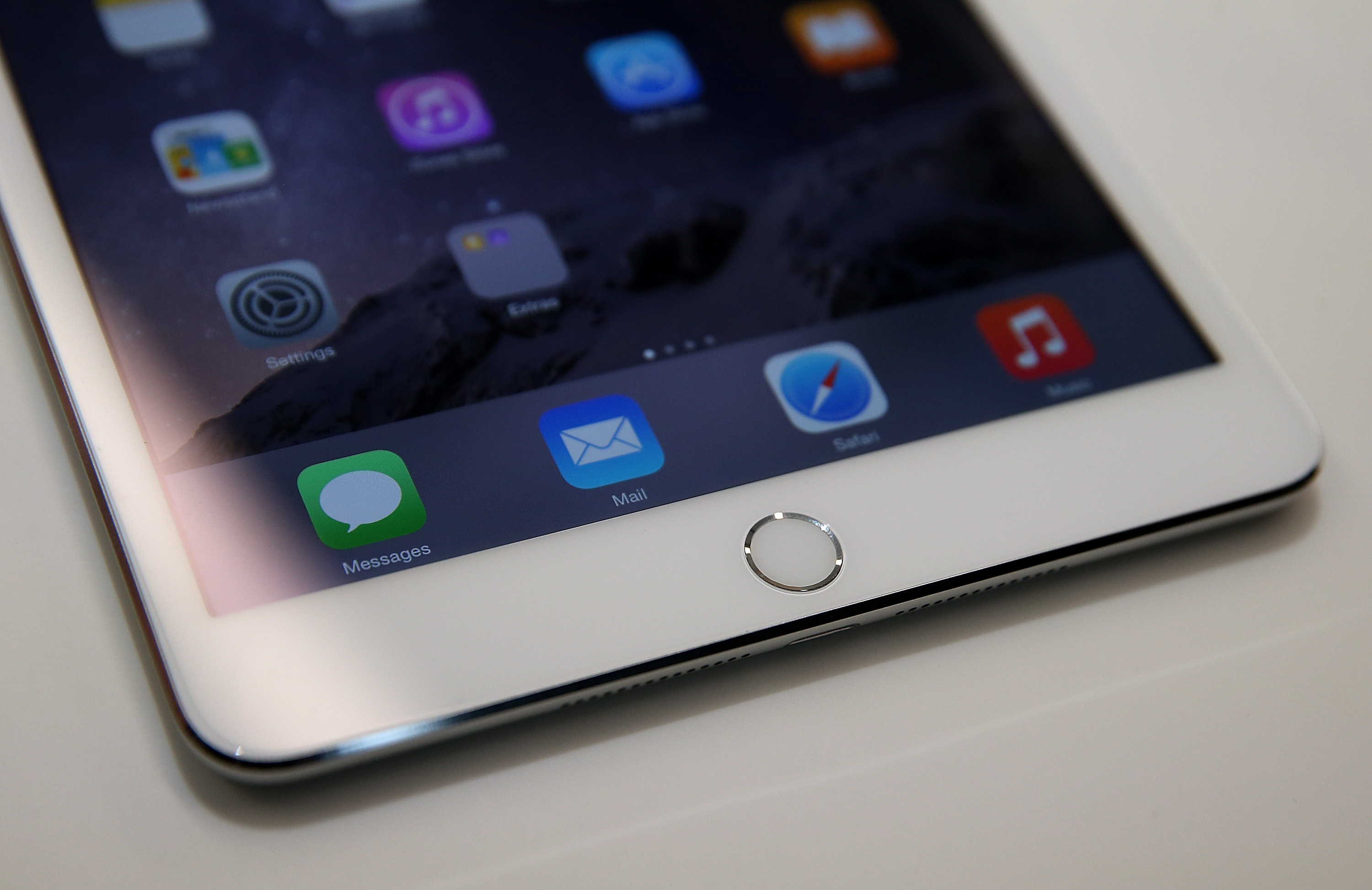 A touch I.D. pad is seen on the new iPad Mini 3 during an Apple special event on October 16, 2014 in Cupertino, California. (Photo by Justin Sullivan/Getty Images)