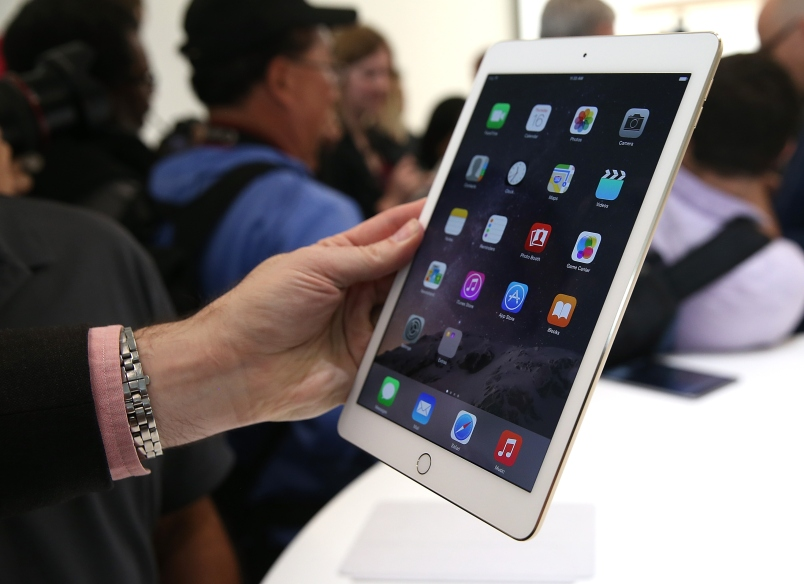 CUPERTINO, CA - OCTOBER 16:  An attendee inspects new iPad Air 2 during an Apple special event on October 16, 2014 in Cupertino, California.  Apple unveiled the new iPad Air 2 and iPad Mini 3 tablets and the iMac with 5K retina display.  (Photo by Justin Sullivan/Getty Images)