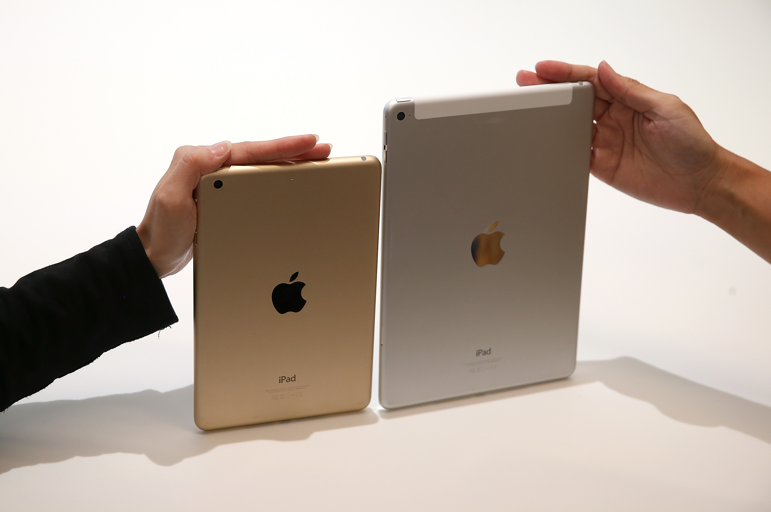 The new iPad Air 2 (R) and iPad Mini 3 are displayed during an Apple special event on October 16, 2014 in Cupertino, California. (Photo by Justin Sullivan/Getty Images)