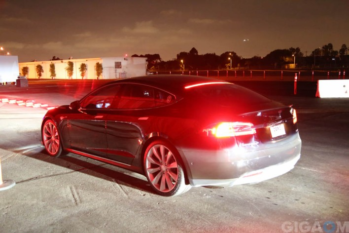 Tesla's P85D under the glowing lights of the launch in Hawthorne, Calif. Image courtesy of Gigaom, Katie Fehrenbacher.