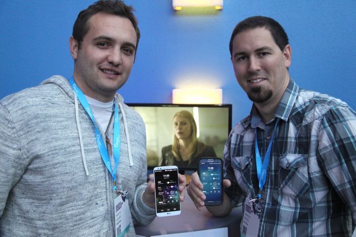 The founders showing off the alpha version of the Reach app at Structure Connect.