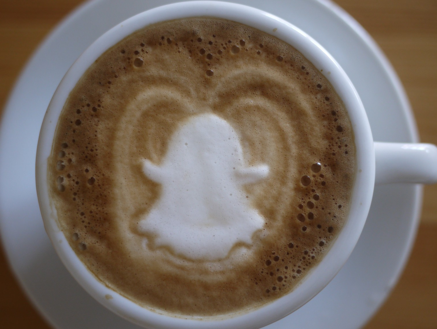 Ephemeral latte art in the shape of the Snapchat logo. Disappears as soon as the first sip is taken.