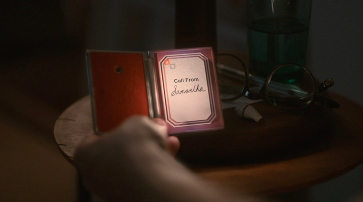 The handheld device in the movie Her, image courtesy of Warner Brothers.