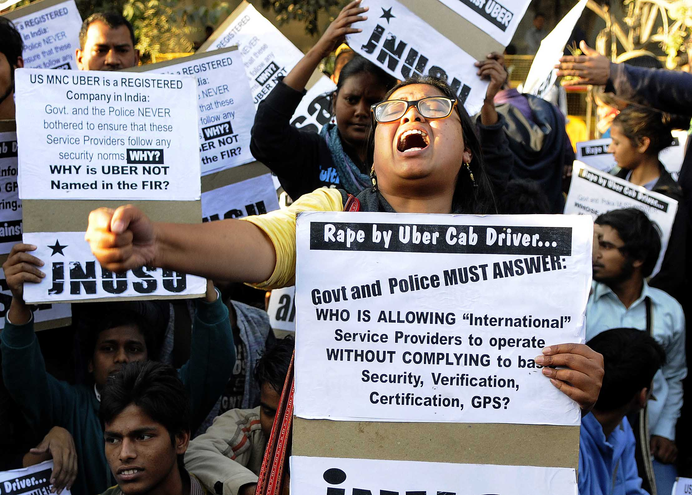 Jawaharlal Nehru University Students' Union (JNUSU) shout slogan against Delhi Police, hold protest against the shocking rape by UBER Cab Driver at PHQ ITO, on December 7, 2014 in New Delhi, India.
