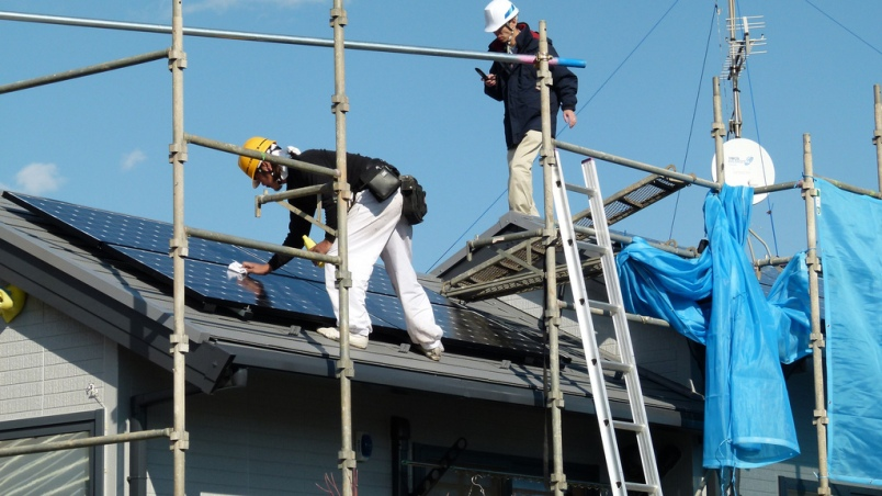 Solar panels being installed on a roof in Japan.
