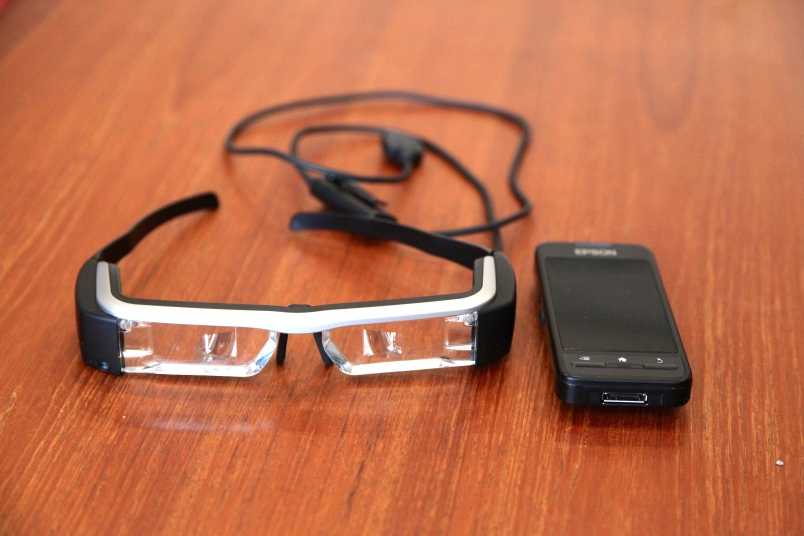 Epson's BT-200 smart glasses and their handheld controller.