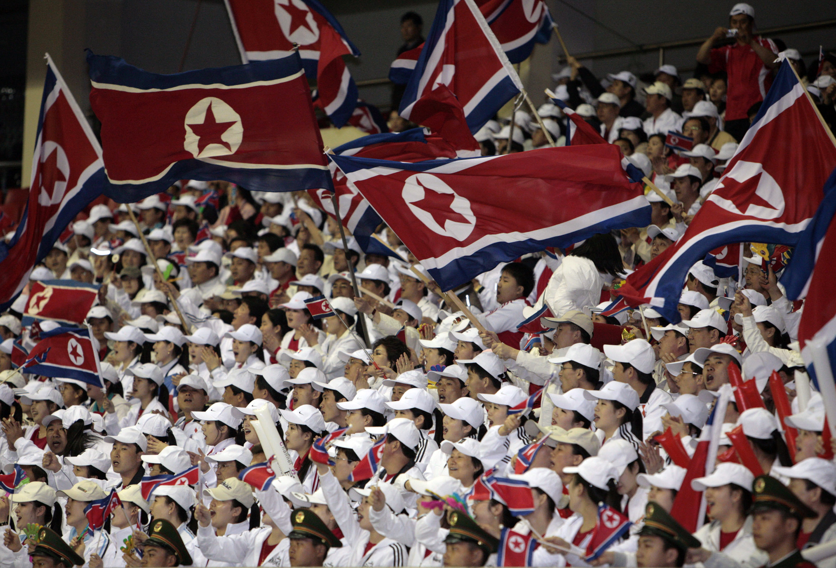 North Korean soccer team fans fly their country's flag at a game against South Korea in Shanghai, China, on March 26, 2008.